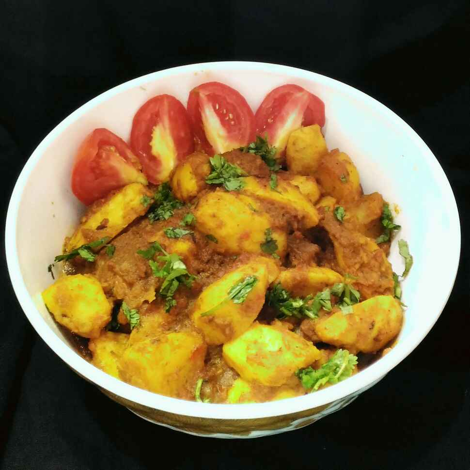 Photo of tomato poray niramish gathi kochur dom by Sanchari Karmakar at BetterButter