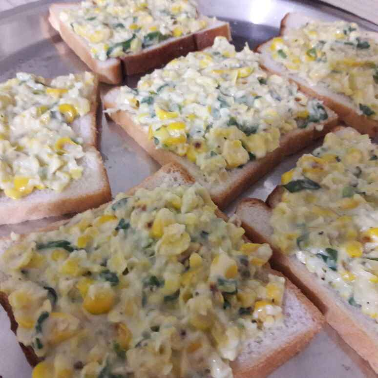 Photo of Sweet corn capsicum bread pizza by Sarala Nahar at BetterButter