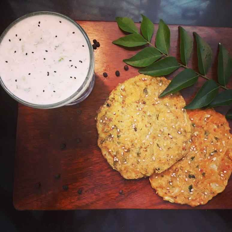 Photo of Cucumber thalipith with Cucumber Raita by Shraddha Tikkas at BetterButter