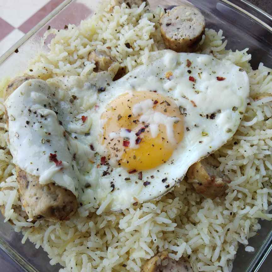 Photo of Sausage butter rice with herbs egg pouch by Sudeshna Mondal at BetterButter