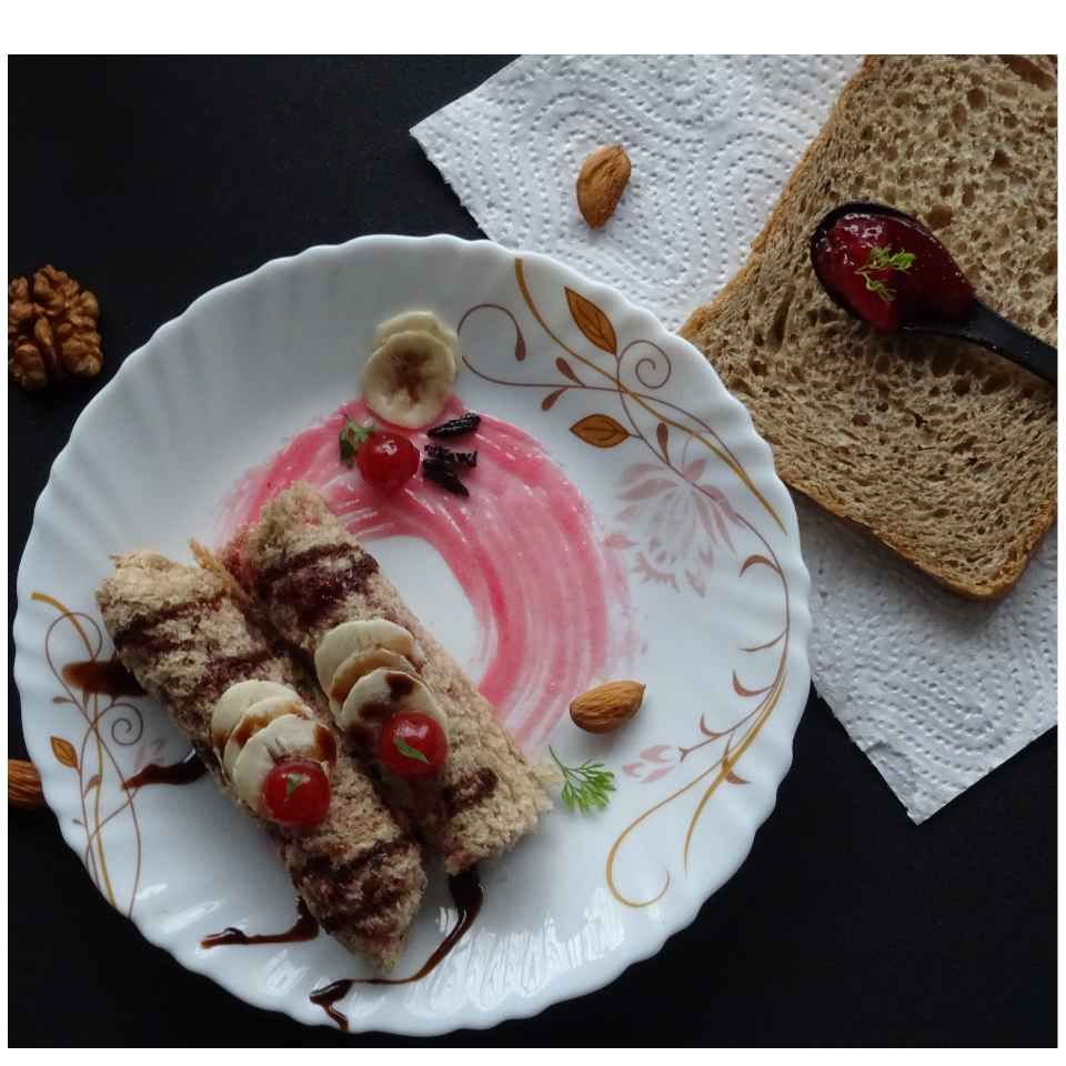 Photo of Multigrain Bread-Jam Roll by Sujata Hande-Parab at BetterButter