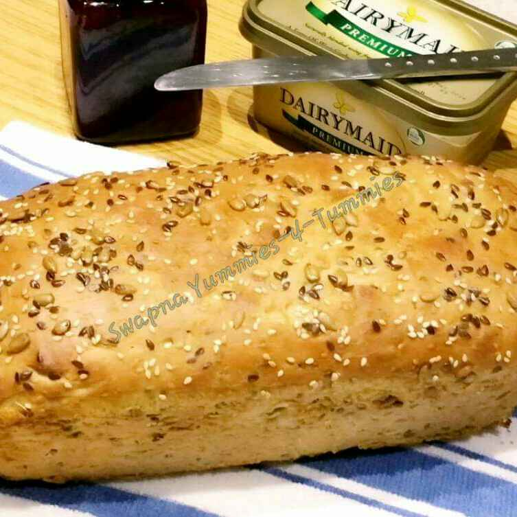 Photo of Multi seeded , Eggless, Butterless Bread loaf  by Swapna Sunil at BetterButter