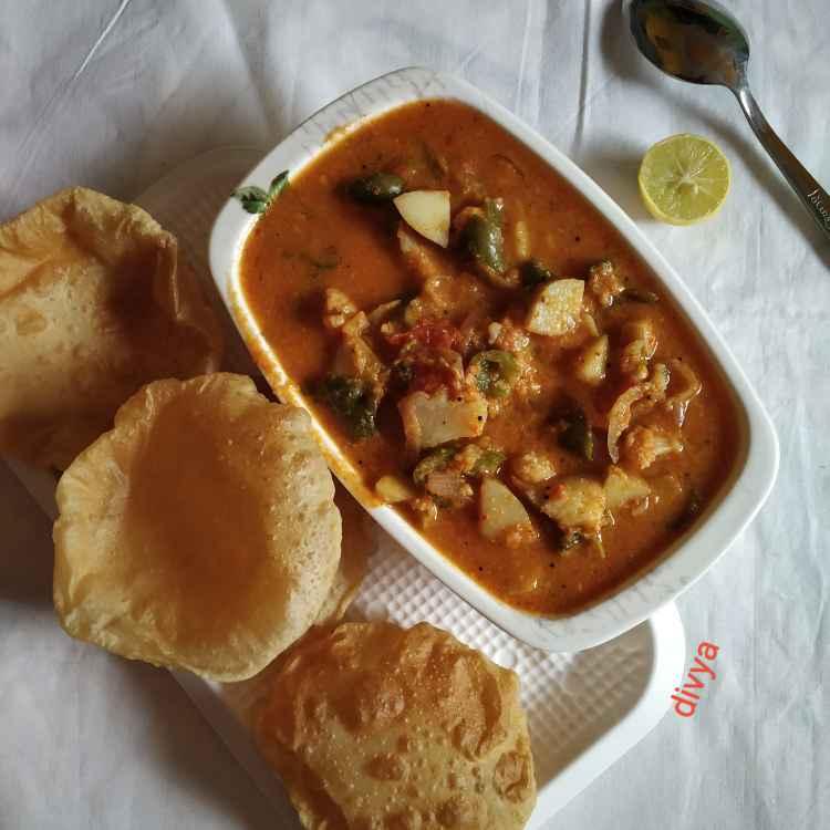 Photo of Puri,alloo capsicum gravy curry by Divya Konduri at BetterButter