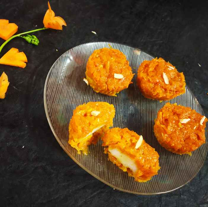 Photo of Carrot halwa and rasagulla terrine (baked cup cake ) by Divya Konduri at BetterButter