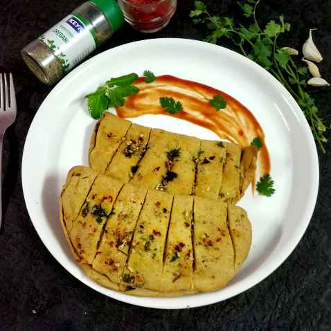 Photo of Home made garlic bread by Divya Konduri at BetterButter