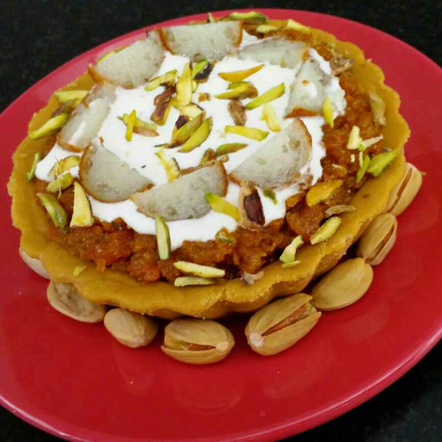 Photo of Gajar Halwa Besan Tart with Rasgulla, cream and pistachio topping by Uma Sarkar at BetterButter