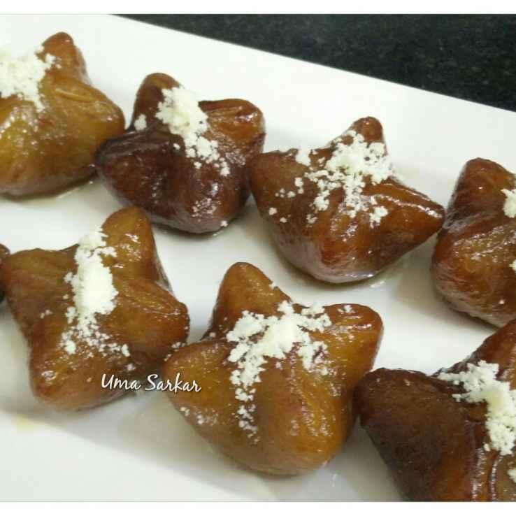 How to make Coconut stuffed  sweet potato pithe