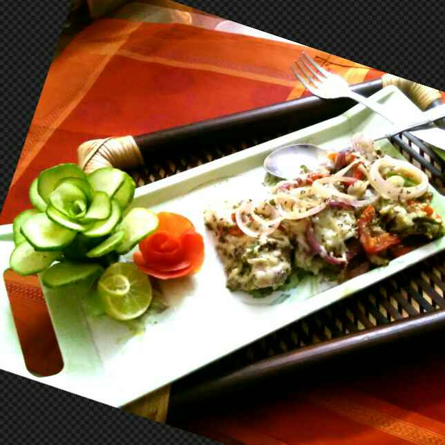 Photo of Green herbs stuffed baked fish by Umasri Bhattacharjee at BetterButter