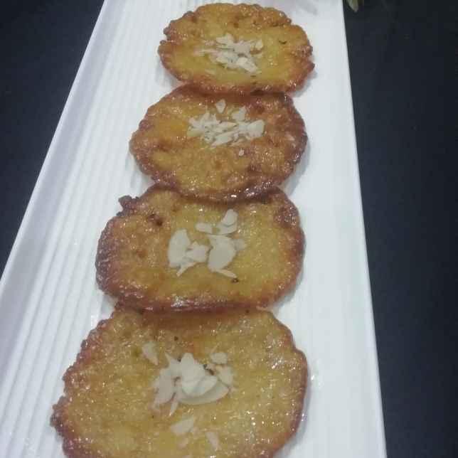 Photo of Wheat flour rabdi malpua by Urvashi Belani at BetterButter