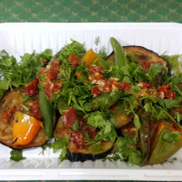 How to make Fried Eggplant salad with baked bell peppers and chillies in vinaigrette dressing.