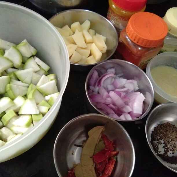 Photo of Spicy achari Bottle gourd and potato curry by Zulekha Bose at BetterButter