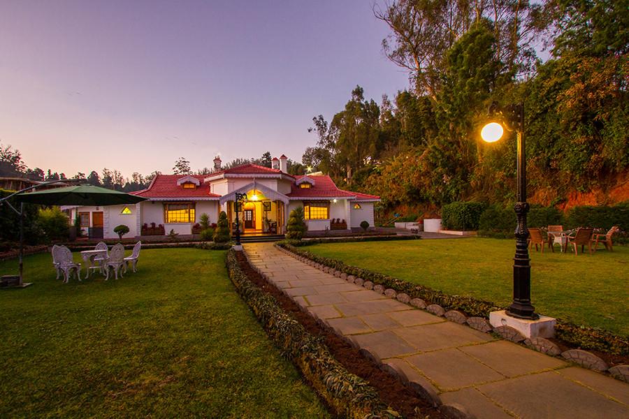 Pleasant dusk time, modern villa and lush green lawn