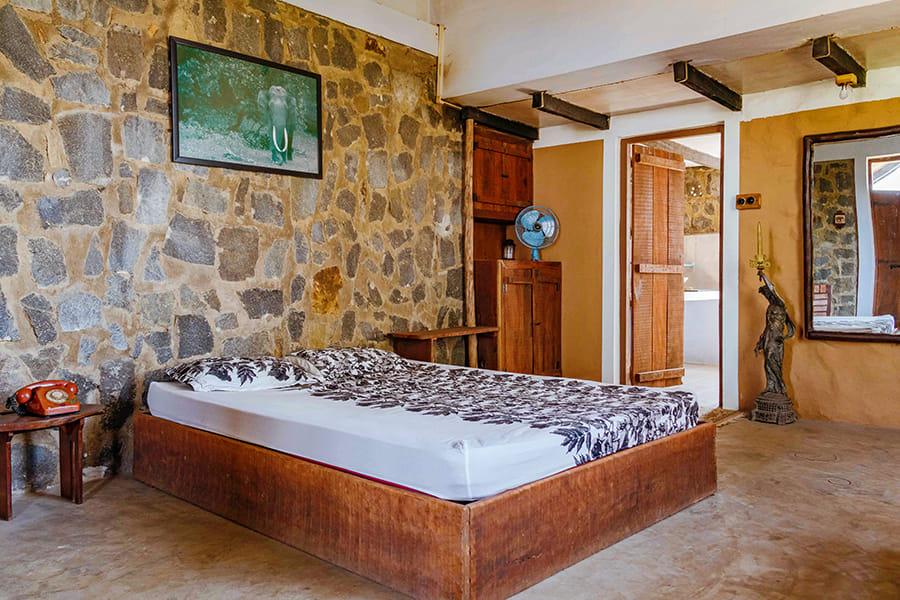 Unique brick and stone interiors, modern furniture in bedroom