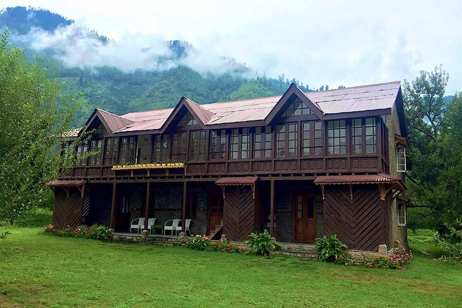 Two storey villa in Manali, dark brown wodden boutique structure