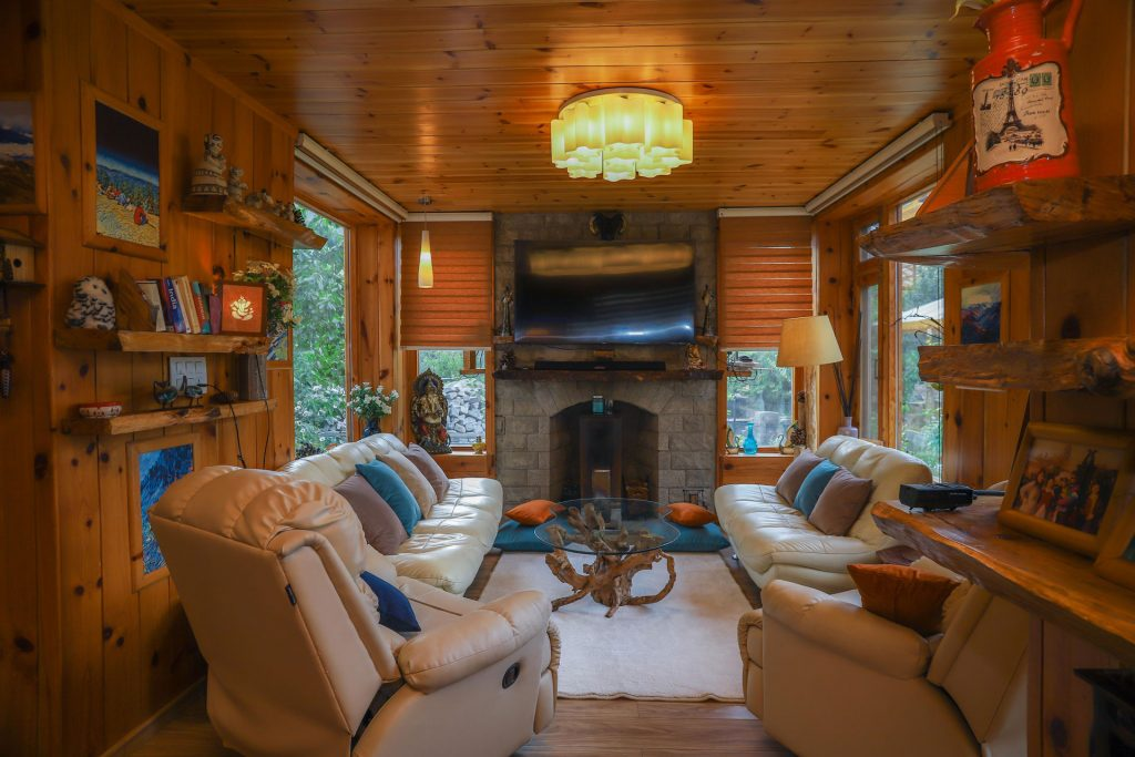Cozy living room in Manali with wooden interiors, fireplace