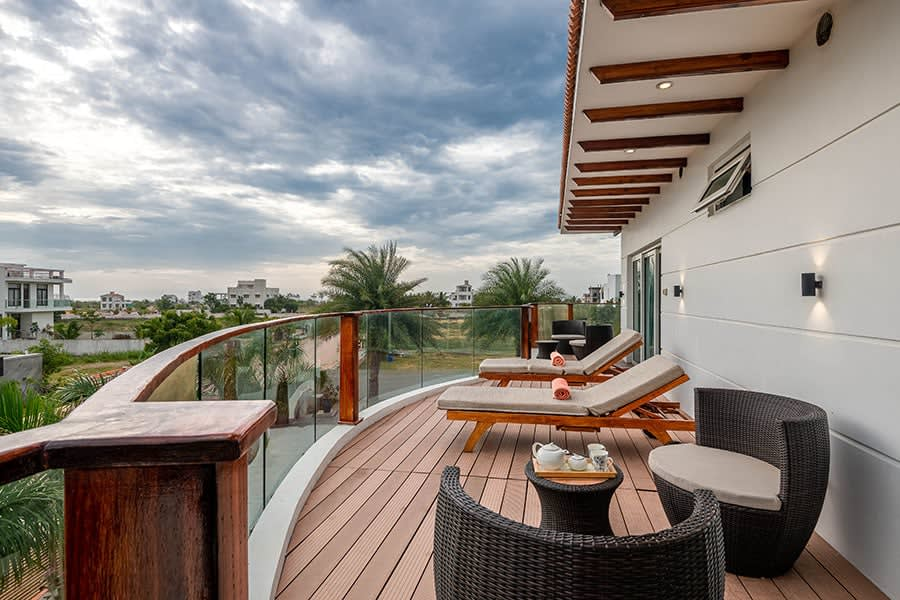 Balcony view from Christmas villa, beach chairs and outdoor seating