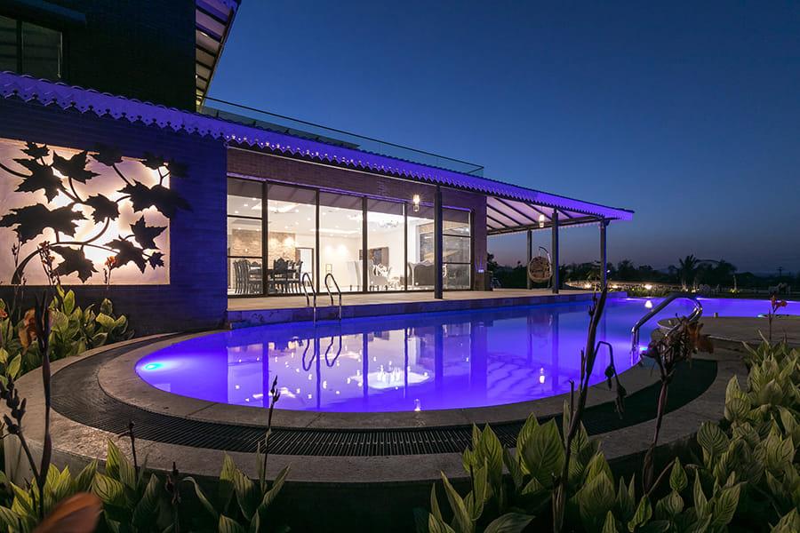 Villa with dimly lit pool