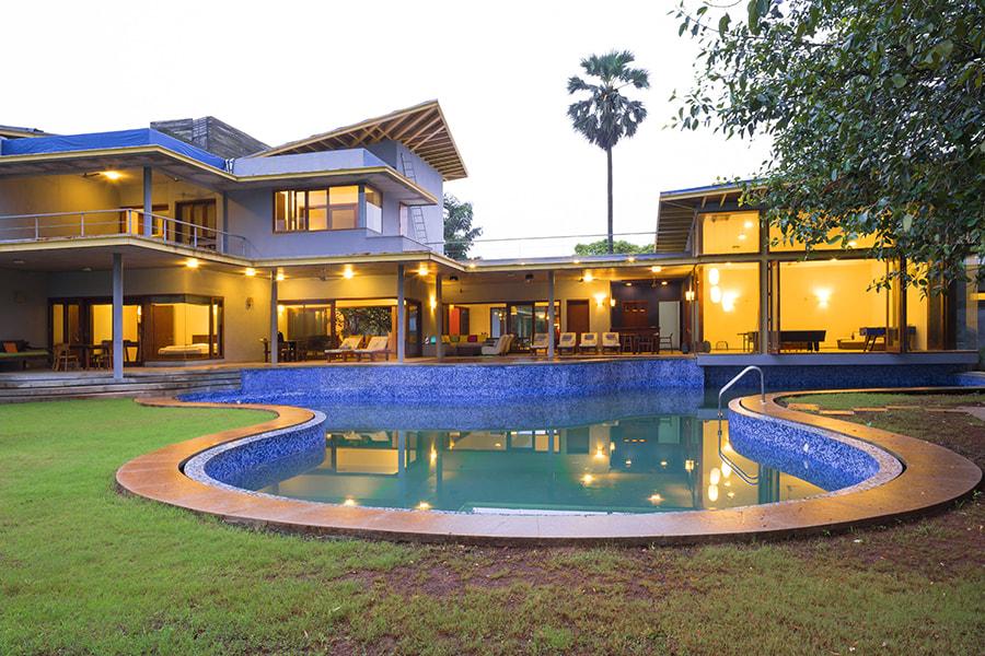 Pool in front of big villa