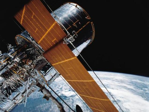 In this April 25, 1990 photograph provided by NASA, most of the giant Hubble Space Telescope can be seen.
