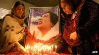 Two women mourn assassinated former Pakistani PM Benazir Bhutto