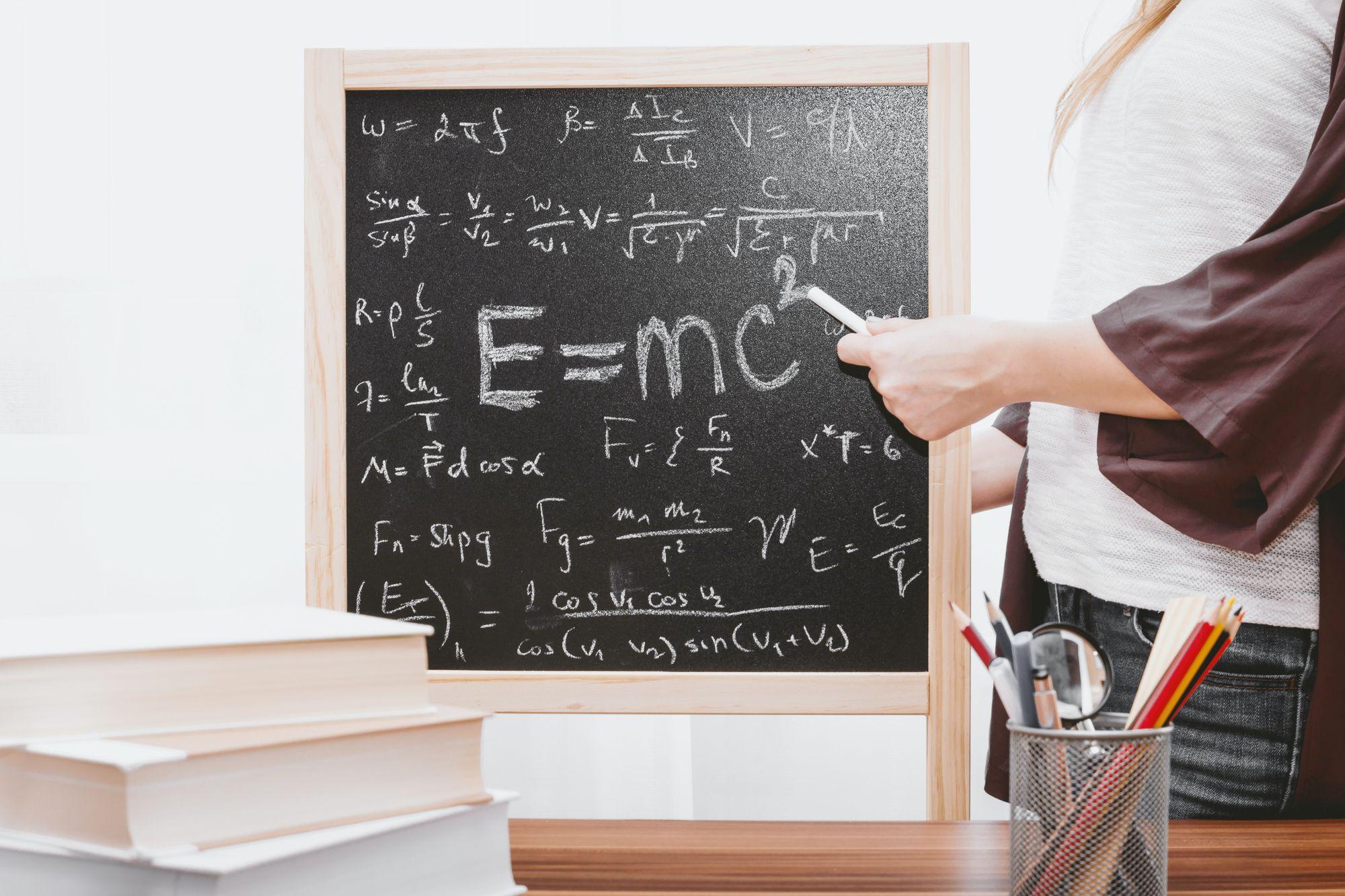 A math problem written on the blackboard