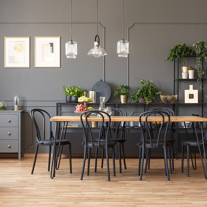 A modern dining room which is so big where there is space for everyone which can accommodate upto 6 people in dining room designs india