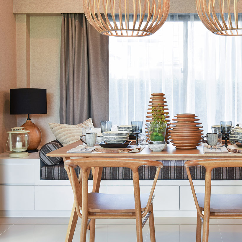 The dining room design whole made up of wood and big wooden hanging lights where the dining table attached to the bed from one side looks like indian dining room design pictures