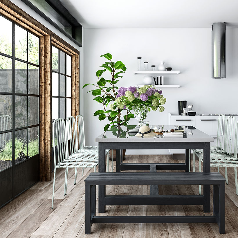 A wash basin in dining room is a add on to the people having food designed by iron chairs and wooden table with a big flower pot and bog windows beside a wall covered with glass windows in arch designs for living room