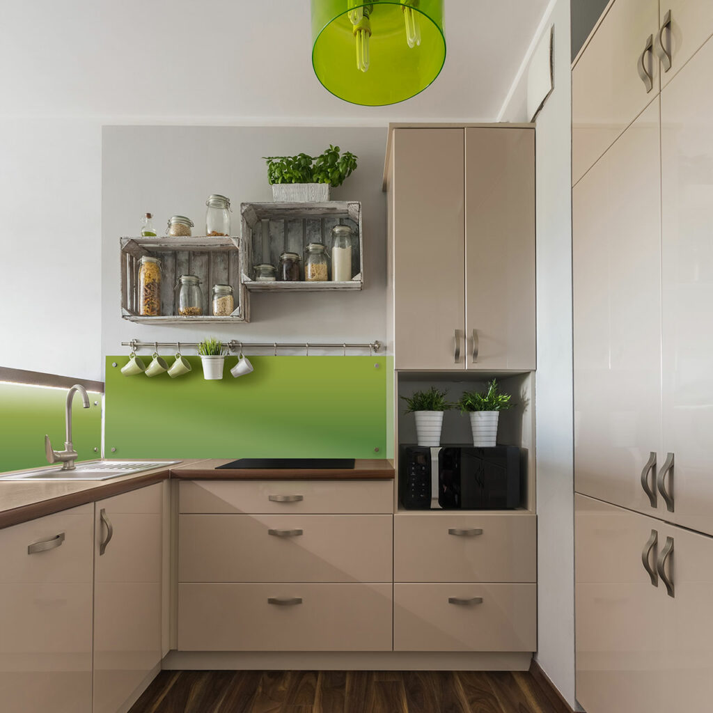 A smart parallel kitchen design with green plants inside the kitchen with very large cabinets attached till the end of the wall
