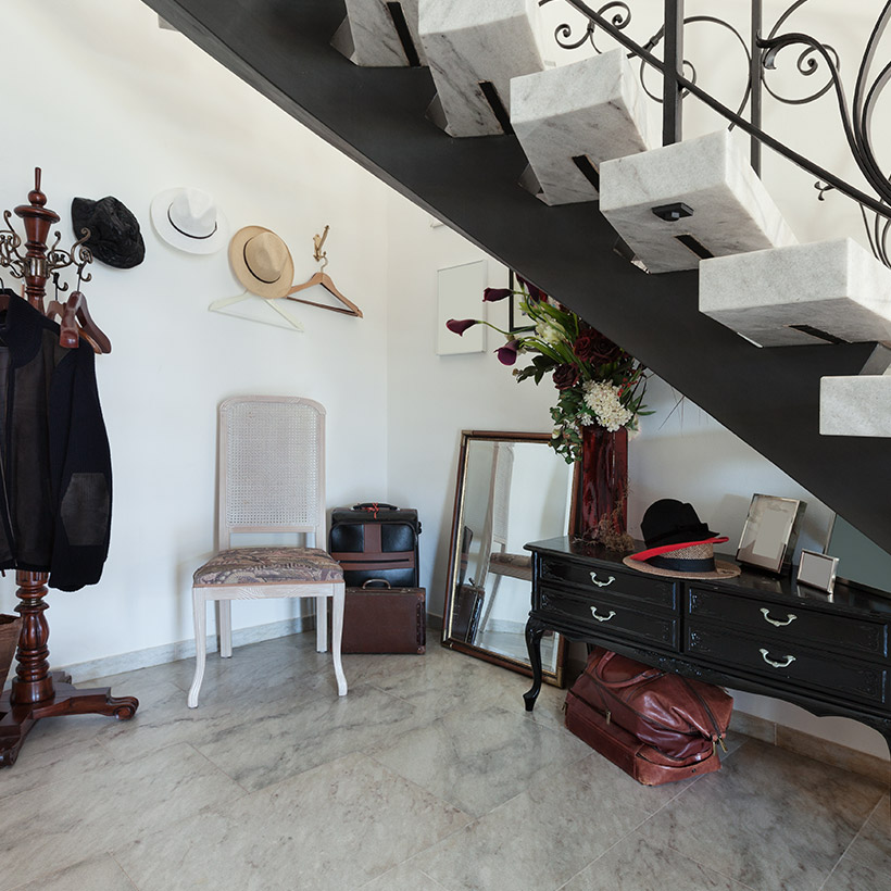 Dress up under the stairs design with dressing table, place a stand to hang your coats/ hats, chair and mirror