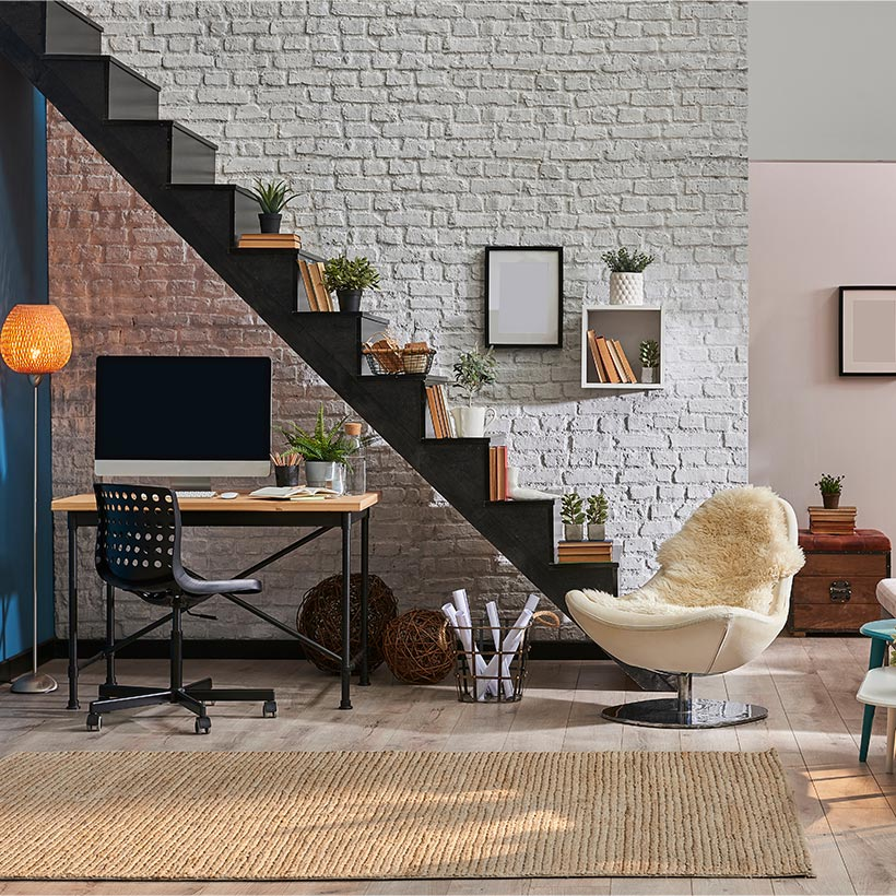 Convert your storage space under the staircase into a compact home office with built-in shelves and a desk