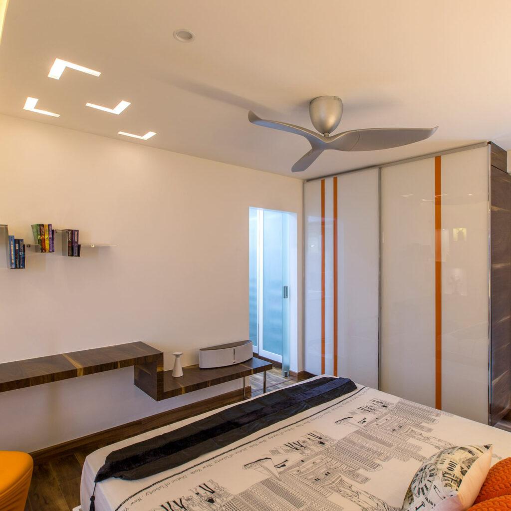 White sliding wardrobe doors add a modern touch with their pared back in wardrobe design slider