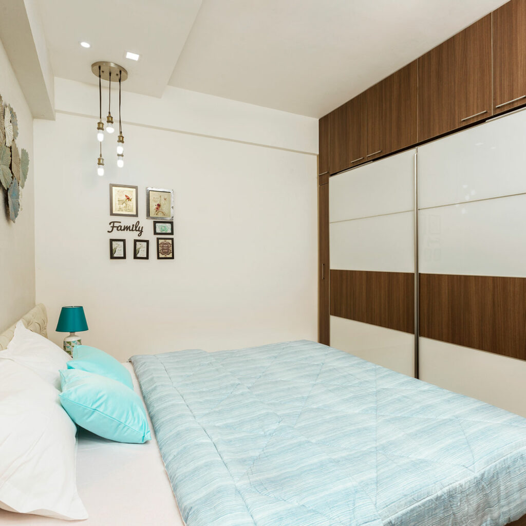 Sliding door wardrobe designs for bedroom with mirrored and patterned sliding doors combine to make the bedroom look