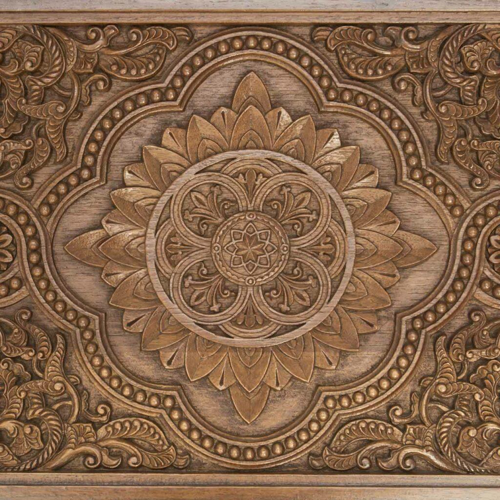 Carved design on wood by craftsmen which shows mandir design in wood