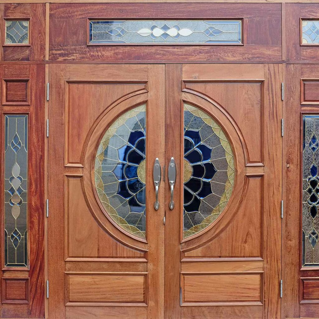 Wooden carved decorated temple doors which indicates a good example of temple wooden door design.