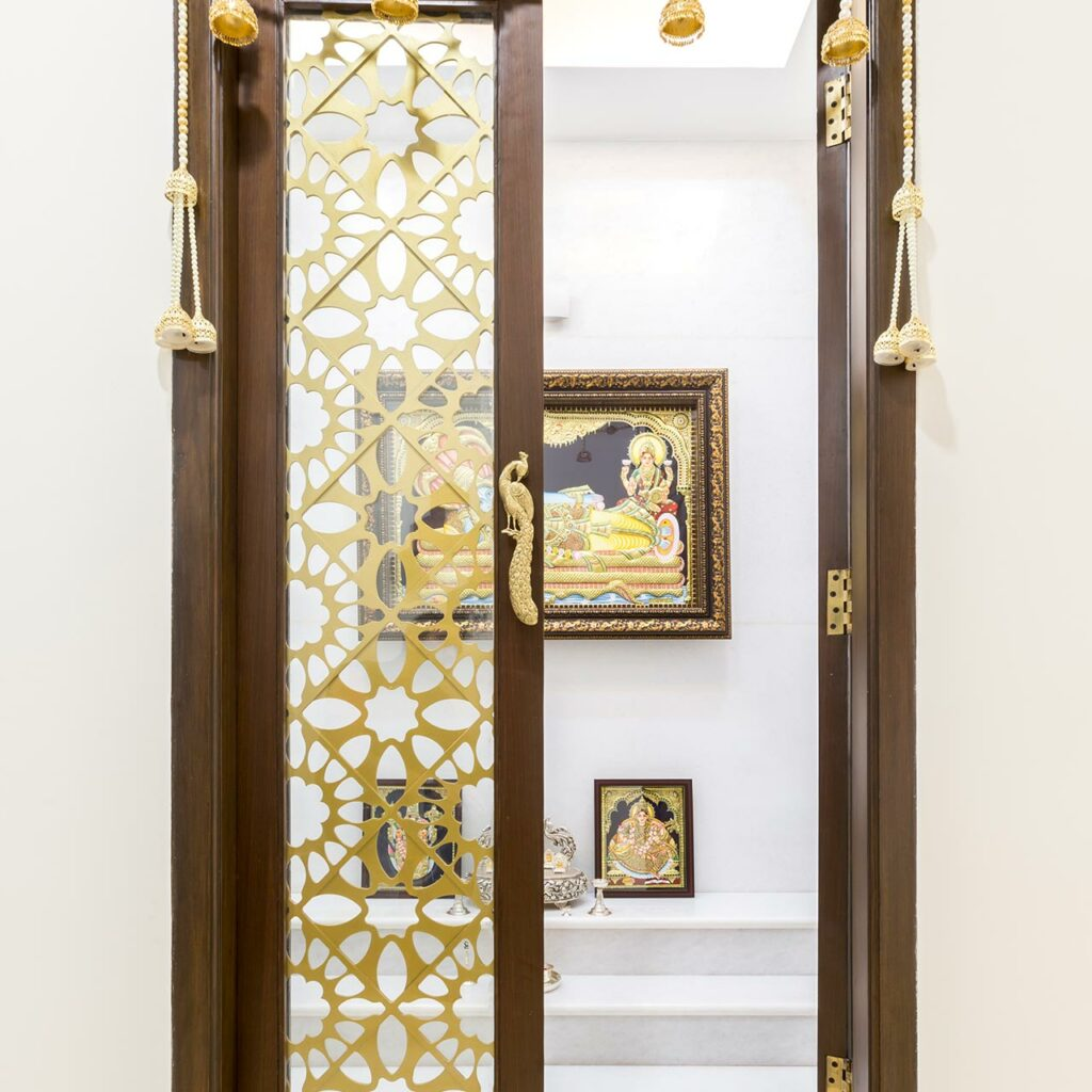 Wooden mandir cupboard which is a perfect combination of utility and look like a wooden mandir design for flats