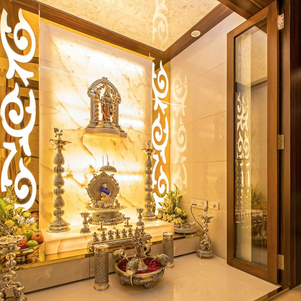A wooden mandir design in the corner of your home which shows a simple wooden temple design for home