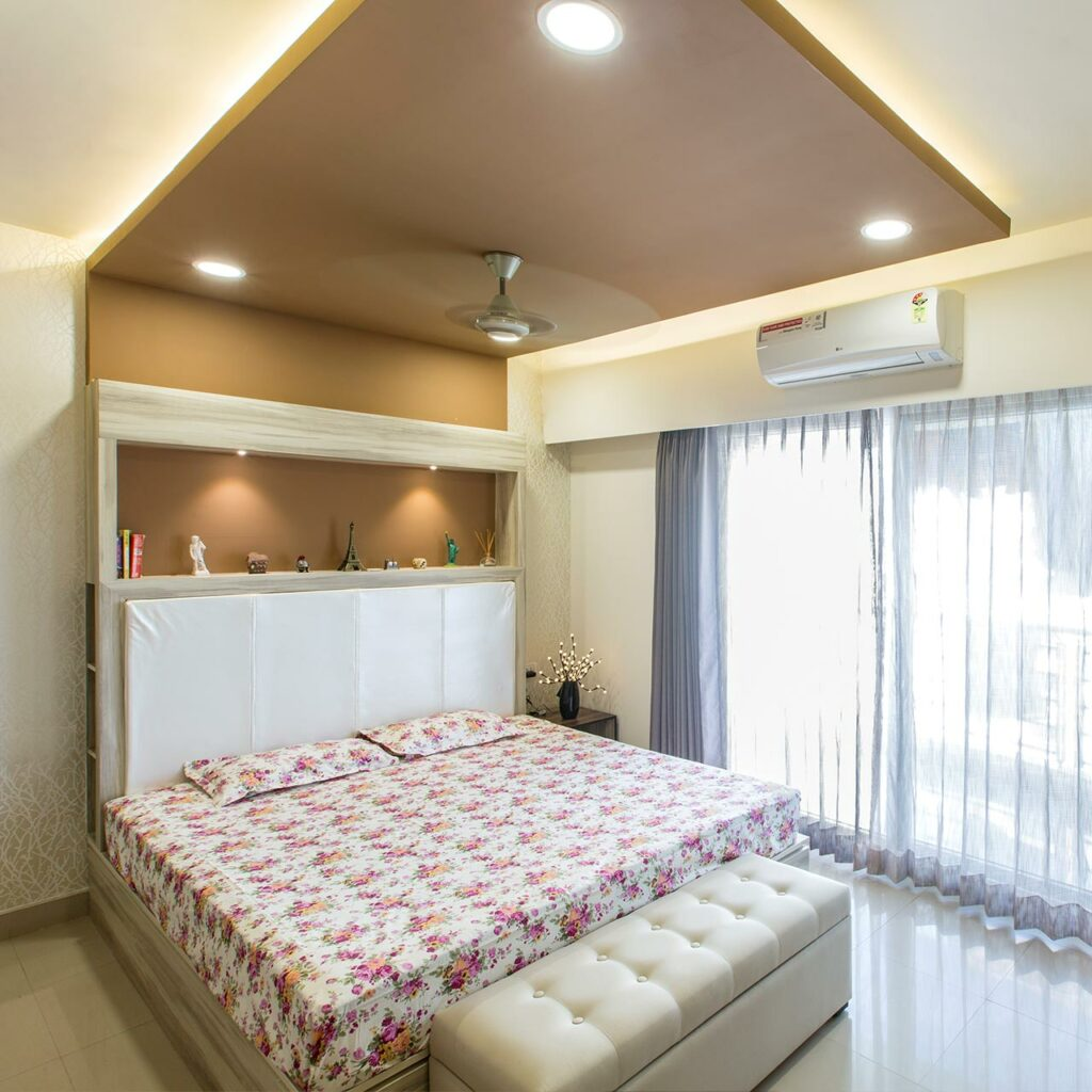 Panel false ceiling design for bedroom with swooping lines of the panel create a striking effect