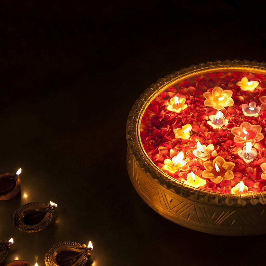 Flower petals with floating diyas in a large bowl is a beautiful decoration you can place across the home.