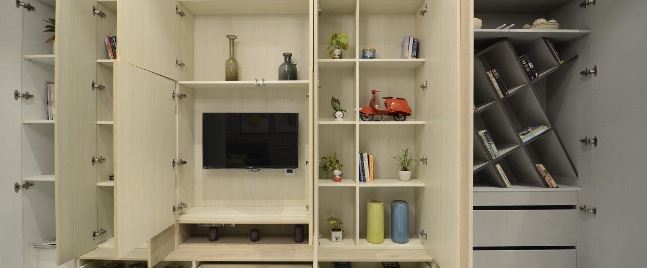 Modular Wardrobe Storage Unit in Minimalist Design With Hidden TV Storage Unit in Mumbai Experience Centre Studio Store.