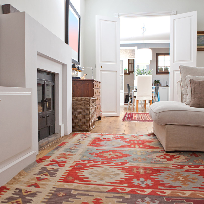 Indian living room interior with a fireplace inside the living room and wooden flooring which gives a traditional look in living room painting ideas india