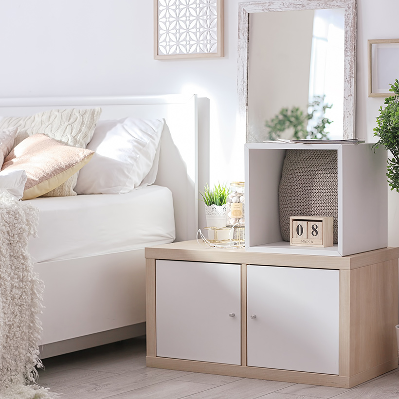 Space maximisation for small bedroom design with a white side cabinet keeps a bedroom clutter free