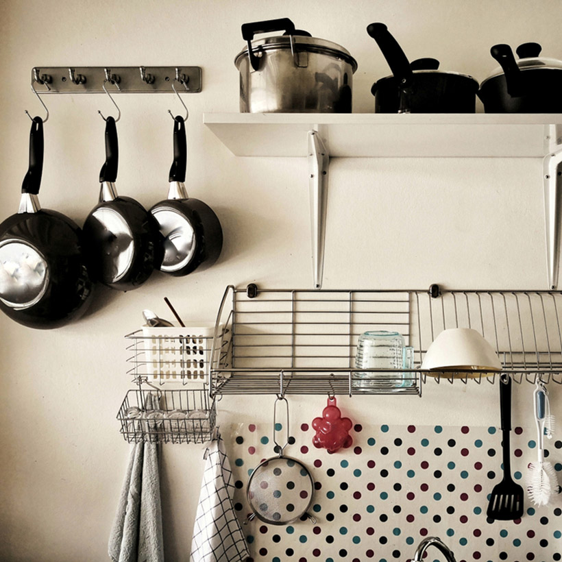 Hanging racks which tell you how to organise a kitchen with iron hanging which can hang utensils for kitchen organisation ideas