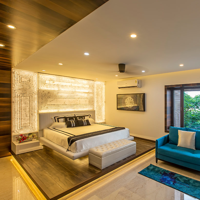 Master bedroom wall decor with custom patterns on feature wall using lights its makes beautiful bedroom wall design