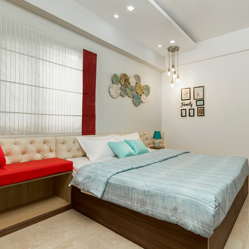Bedroom wall design by putting up rosette flowers on bedroom wall its look like a modern bedroom wall design