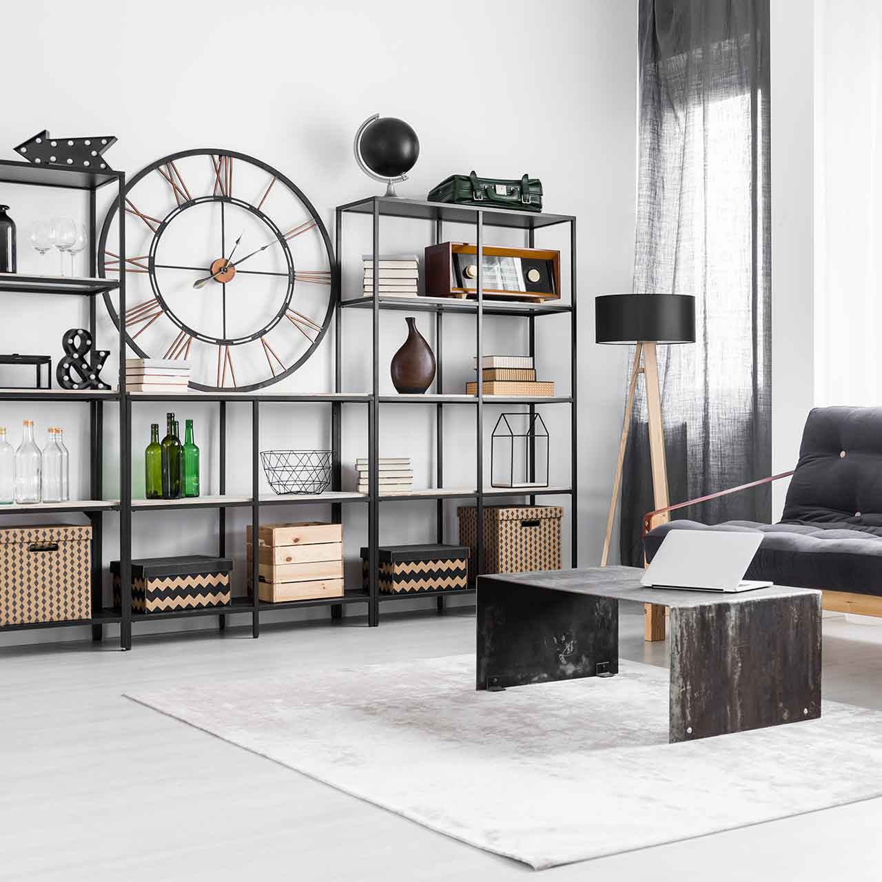 Industrial style living room design with white typographic prints, factory window meets shaggy rugs, iron piping, and wooden floors