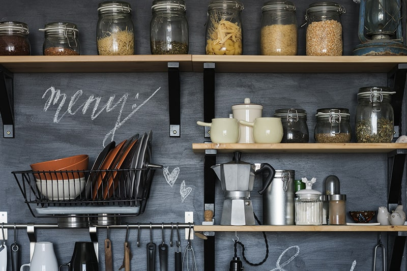 Kitchen wall shelves design with wooden shelves on black brackets with metal accents