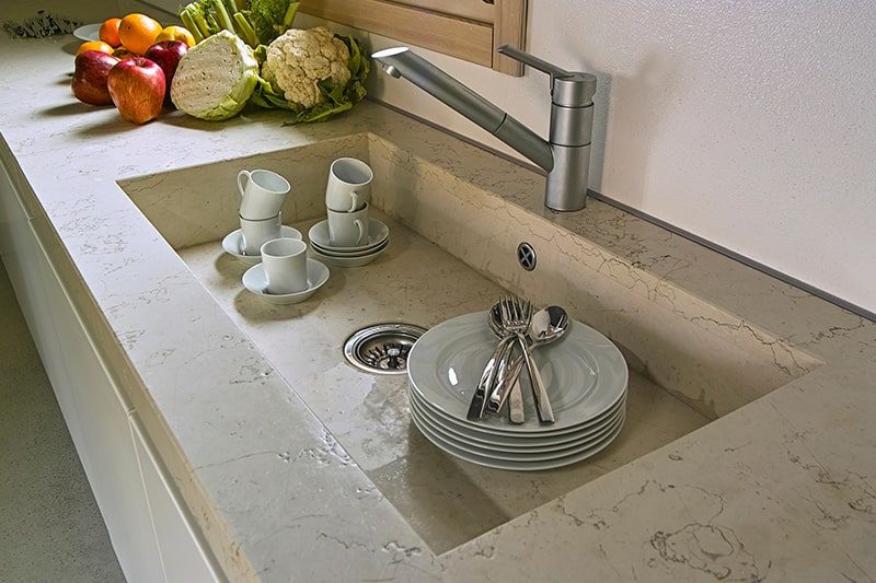 Integrated kitchen sink design made of marble, same as the countertop