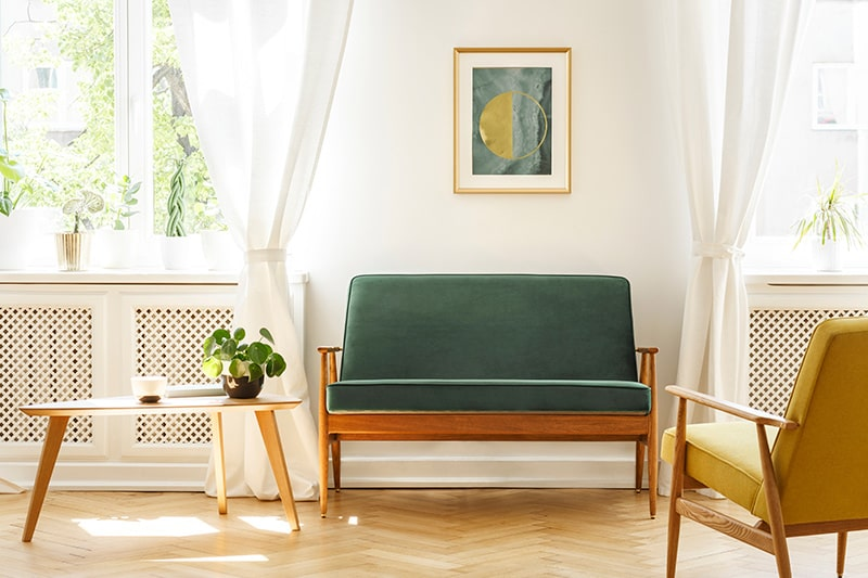 Wooden sofa design for living room with a green and yellow mid-century sofa