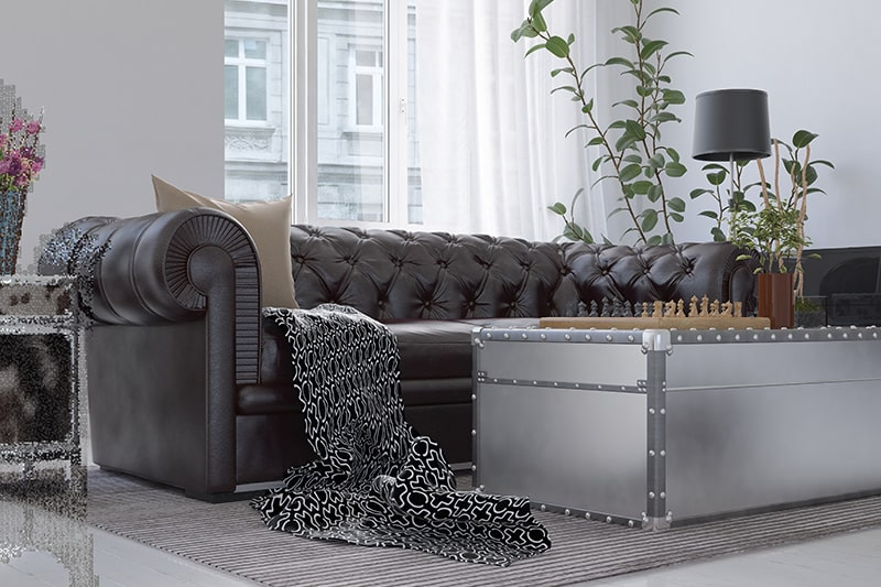 Leather sofa design for living room interiors with a brown leather chesterfield fits